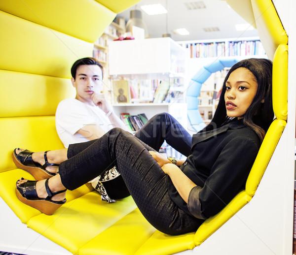 couple students in univercity library, looking book, preparing to exam, having fun, making selfie, l Stock photo © iordani