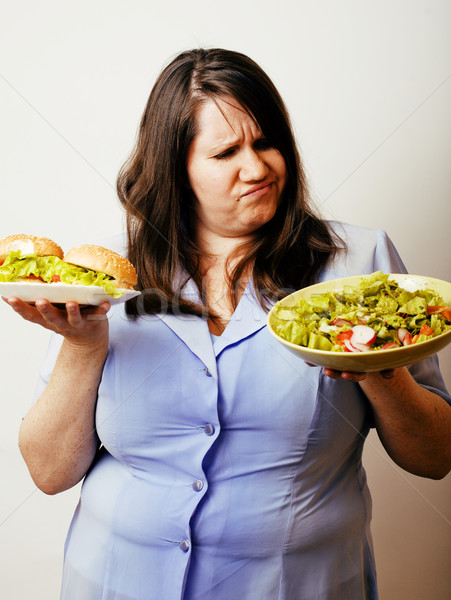 Yağ beyaz kadın seçim hamburger salata Stok fotoğraf © iordani