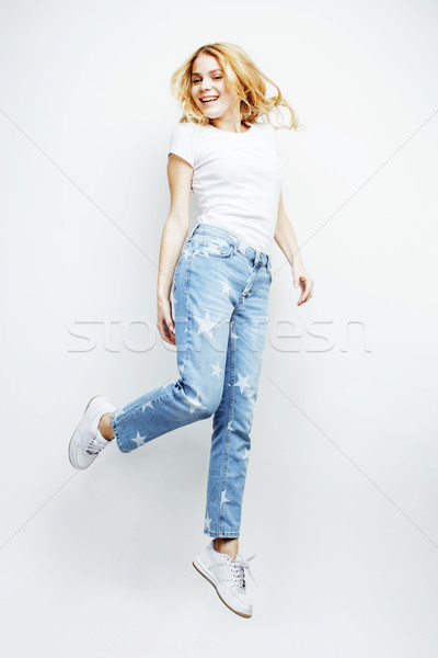 young pretty blond girl jumping isolated on white background, lifestyle flying people concept  Stock photo © iordani