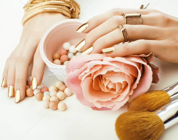 woman hands with golden manicure and many rings holding brushes, makeup artist stuff stylish, pure c Stock photo © iordani