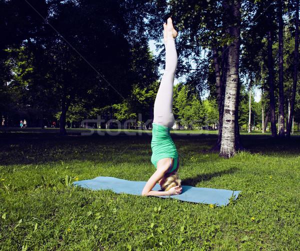 blonde real girl doing yoga in green park, lifestyle sport peopl Stock photo © iordani