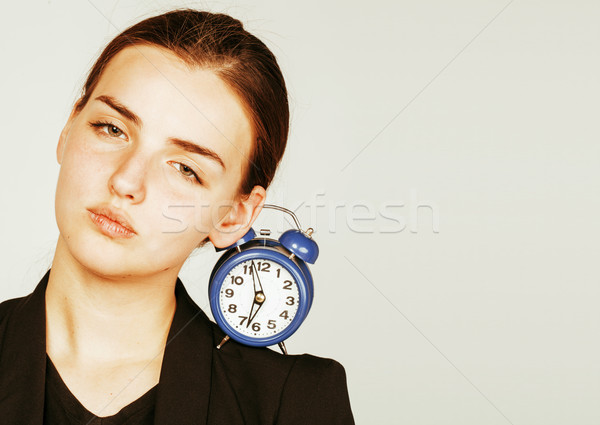 young beauty woman in business style costume waking up for work early morning on white background Stock photo © iordani