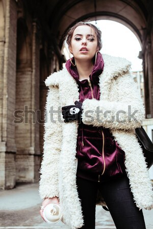 young pretty stylish teenage girl outside in city wall with graf Stock photo © iordani