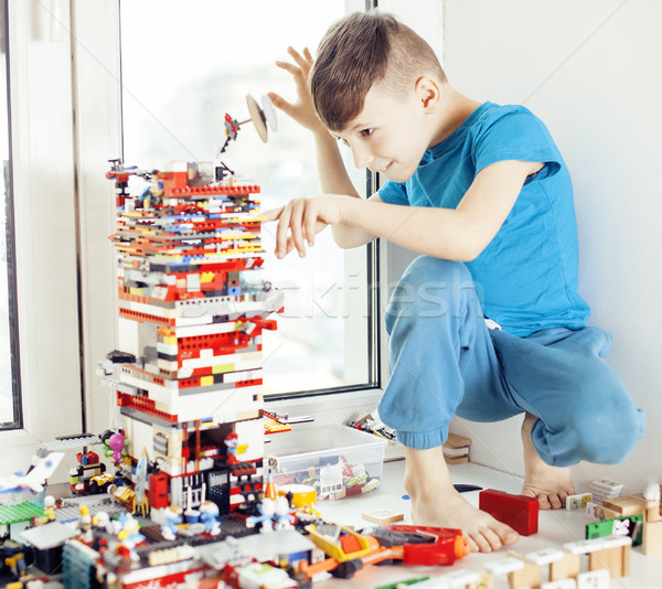 little cute preschooler boy playing lego toys at home happy smiling, lifestyle children concept Stock photo © iordani