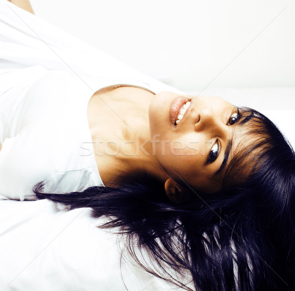 pretty mulatto brunette woman in bed, cant sleep Stock photo © iordani