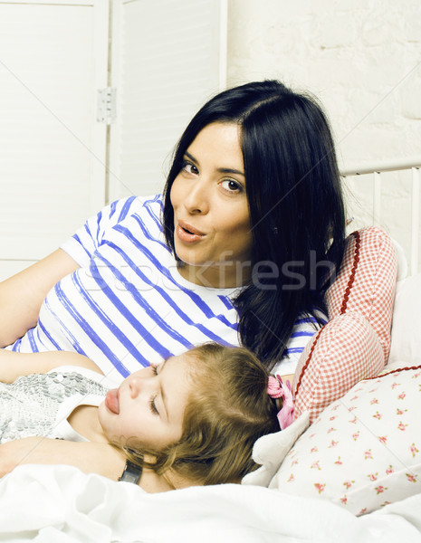 portrait of happy real mother and her daughter playing in bad, l Stock photo © iordani