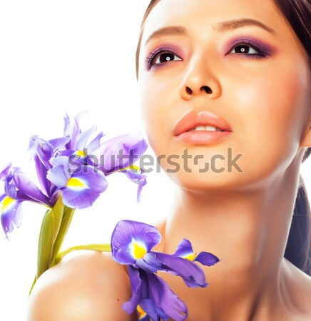 young pretty asian woman with flower orchid close up isolated spa Stock photo © iordani