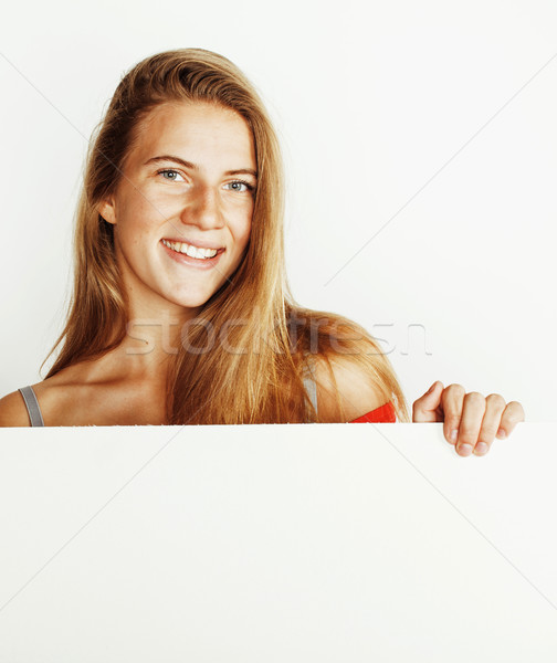 young pretty blonde girl with placard on white background half n Stock photo © iordani