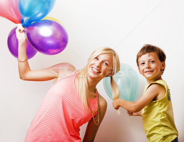 pretty real family with color balloons on white background, blon Stock photo © iordani