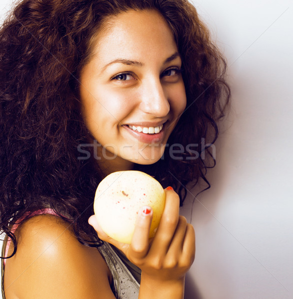 pretty young real tenage girl eating apple close up smiling Stock photo © iordani