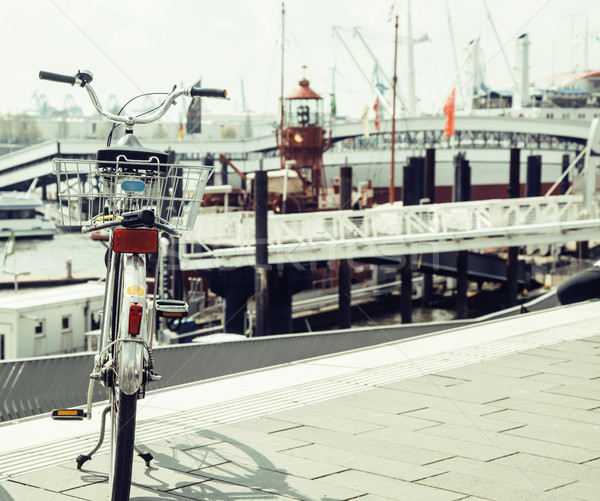 postcard view of Hamburg harbour, parking bicycle at the shore Stock photo © iordani
