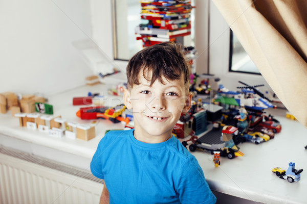 Küçük sevimli okul öncesi erkek oynama oyuncaklar Stok fotoğraf © iordani