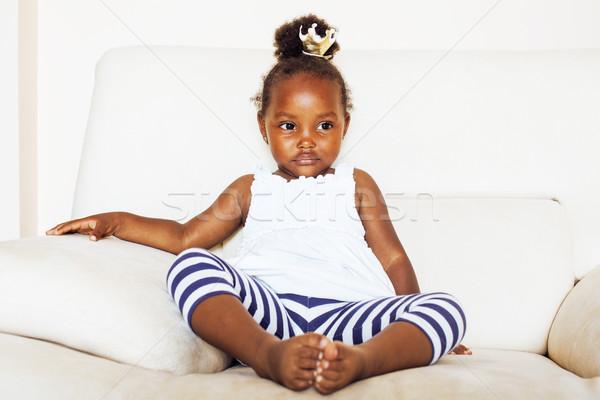 little pretty african american girl sitting in white chair weari Stock photo © iordani