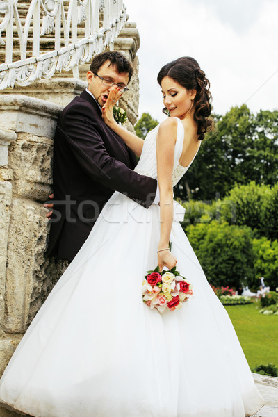 very beautiful bride with groom hugging and dancing in green par Stock photo © iordani