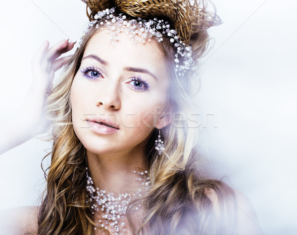 beauty young snow queen in fairy flashes with hair crown on her head Stock photo © iordani