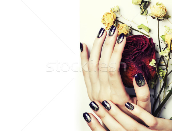 close up picture of manicure nails with dry flower red rose Stock photo © iordani