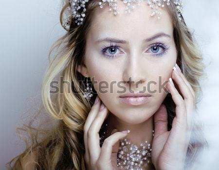 young blonde woman with glamour makeup and hairstyle waves close Stock photo © iordani