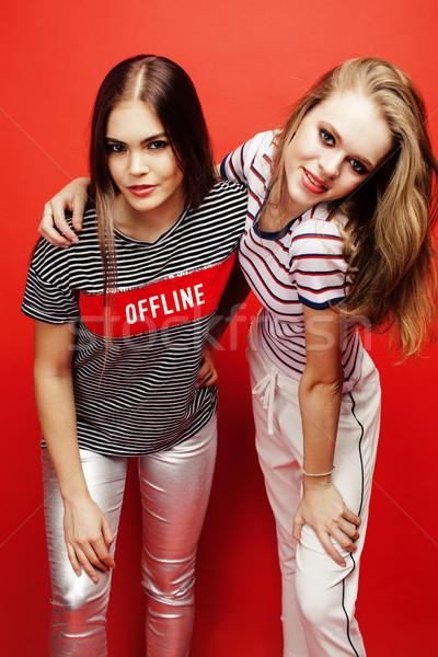 two best friends teenage girls together having fun, posing emotional on red background, besties happ Stock photo © iordani