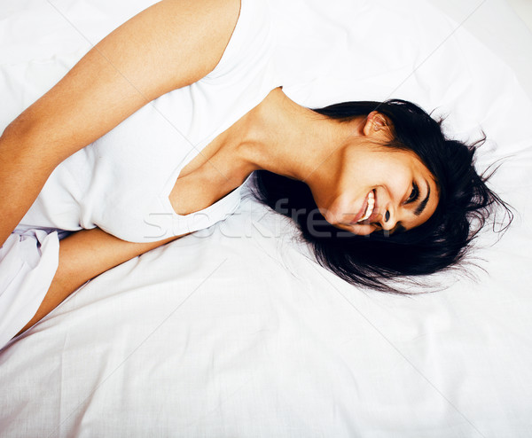 pretty real mulatto brunette woman in bed, cant sleep mad look Stock photo © iordani