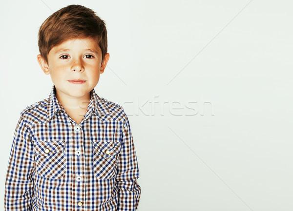 young pretty little cute boy kid wondering, posing emotional fac Stock photo © iordani