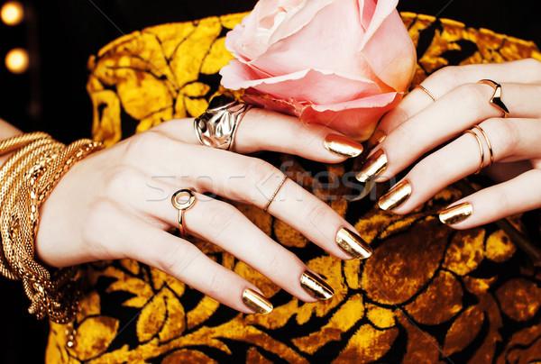 Nő kezek arany manikűr ékszerek jelmez Stock fotó © iordani