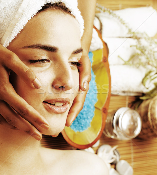 stock photo attractive lady getting spa treatment in salon, close up asian tan hands on face  Stock photo © iordani