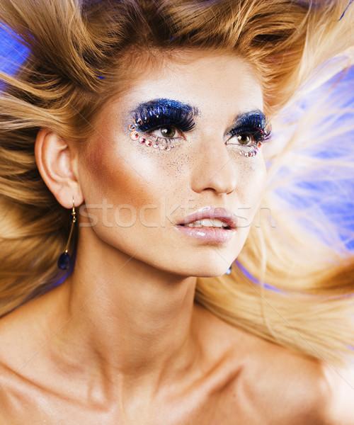 Szépség fiatal nő kreatív smink repülés haj Stock fotó © iordani