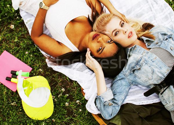 Iki güzel okul kızlar çim mutlu Stok fotoğraf © iordani