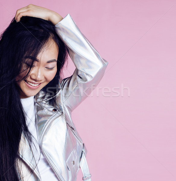 young pretty smiling asian korean girl wearing modern fashion clothers on pink background, lifestyle Stock photo © iordani
