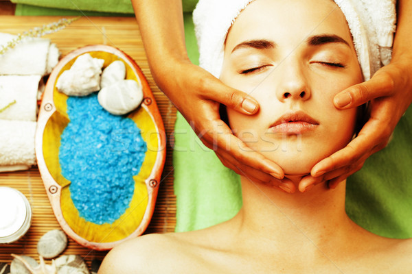 stock photo attractive lady getting spa treatment in salon, close up asian hands on face Stock photo © iordani