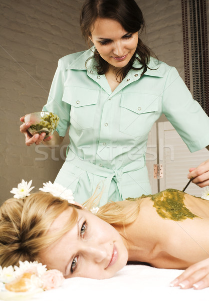 stock photo attractive lady getting spa treatment in salon, massage doctor smiling care pretty Stock photo © iordani