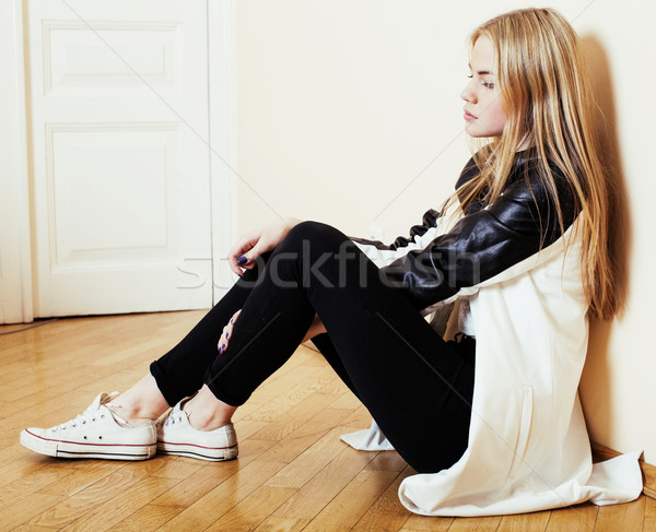 young pretty teenage blond girl sitting on floor at home despair sad alone, lifestyle concept Stock photo © iordani