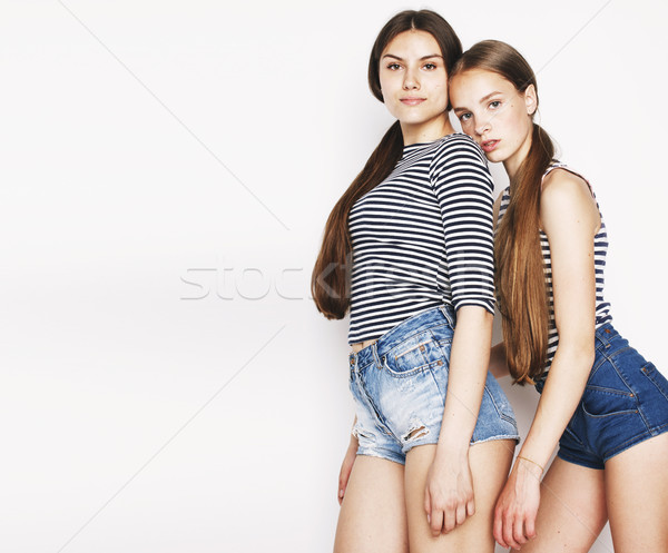 Stock photo: two cute teenagers having fun together isolated on white