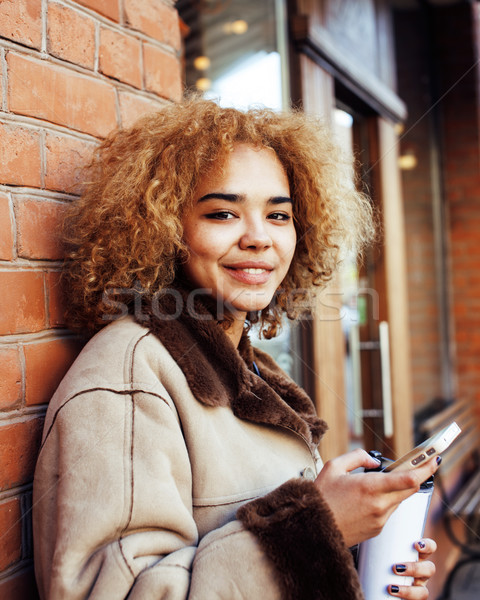 Stock photo: young pretty african american women drinking coffee outside in c