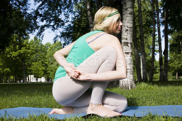 blonde real girl doing yoga in green park, lifestyle sport people concept  Stock photo © iordani