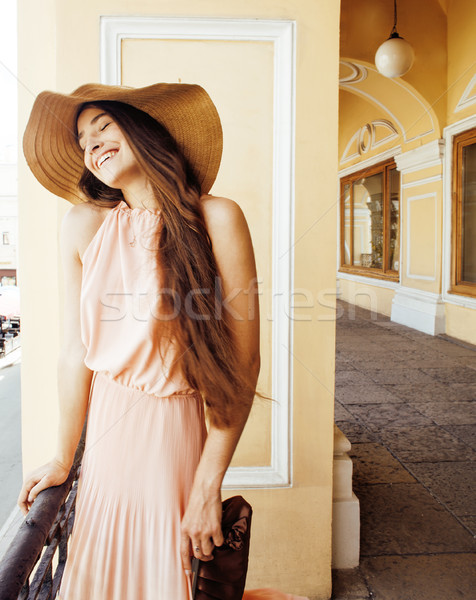 young pretty smiling woman in hat with bags on shopping at storefront, lifestyle real people concept Stock photo © iordani