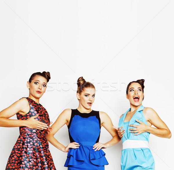 Csoport sokoldalú elegáns hölgyek fényes ruhák Stock fotó © iordani