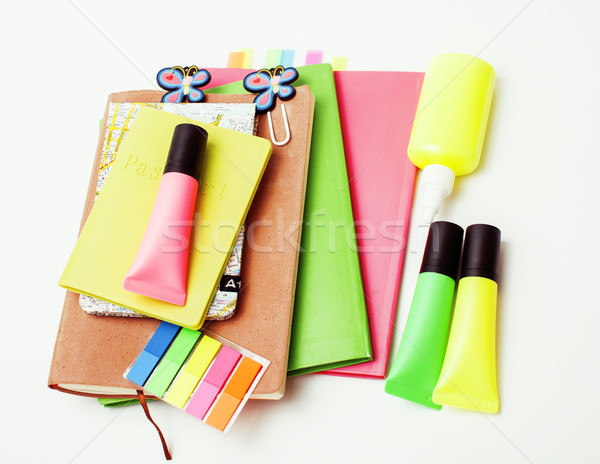 business, education and technology concept - close up of notebook, paper stickers, pencil different  Stock photo © iordani