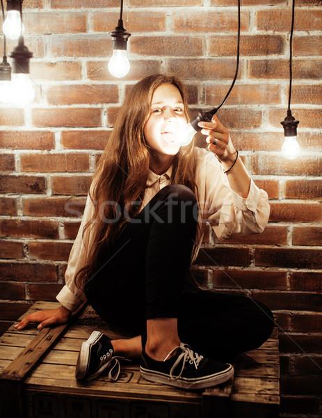 Csinos tinilány szórakozás elegáns modern padlás Stock fotó © iordani