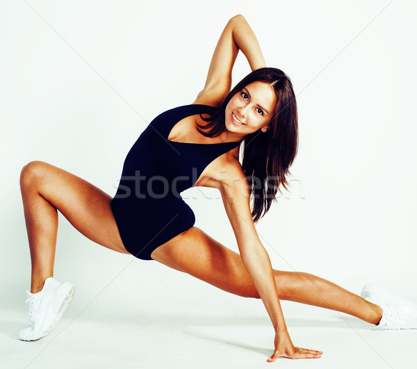 young pretty slim woman doing gym isolated on white background, healthcare people concept Stock photo © iordani