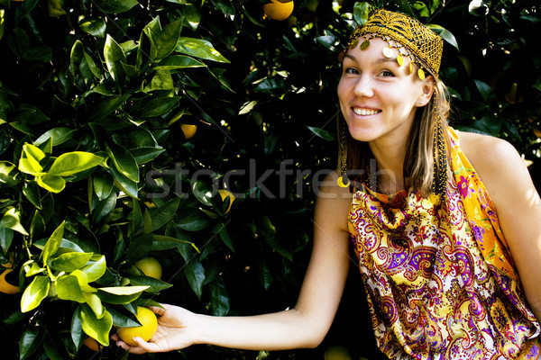 pretty islam woman in orange grove smiling, real muslim girl che Stock photo © iordani