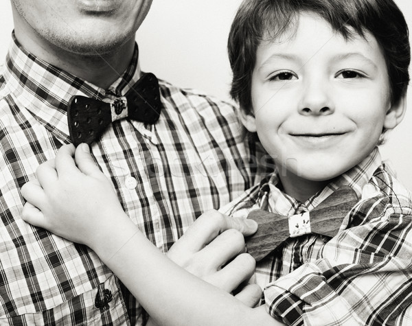 father with son in bowties on white background, casual look family Stock photo © iordani