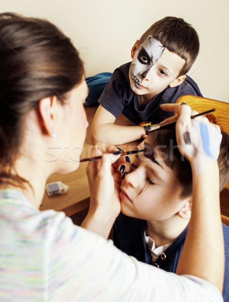 little cute child making facepaint on birthday party, zombie Apocalypse facepainting, halloween prep Stock photo © iordani