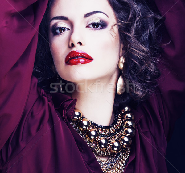 beauty rich brunette woman with a lot of jewellery, hispanic curly lady close up Stock photo © iordani