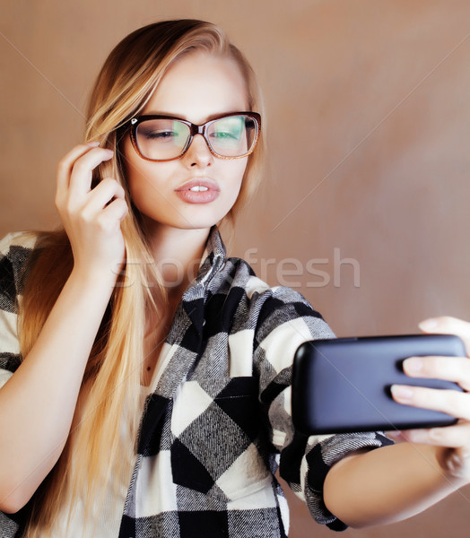 young pretty blond woman with smartphone posing smiling, making  Stock photo © iordani