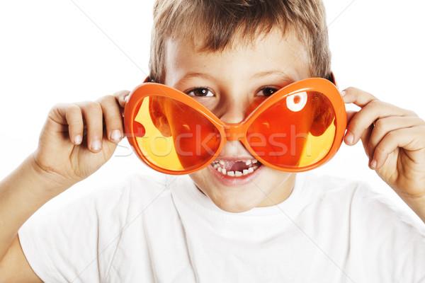 little cute boy in orange sunglasses pointing isolated close up  Stock photo © iordani