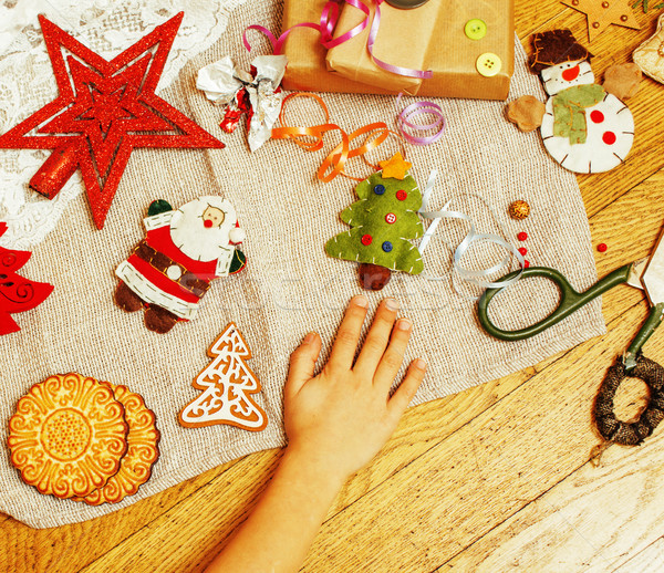 handmade christmas gifts in mess with toys, candles, fir, ribbon Stock photo © iordani