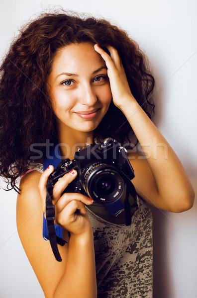 Küçük sevimli genç kız kıvırcık saçlı kamera Stok fotoğraf © iordani
