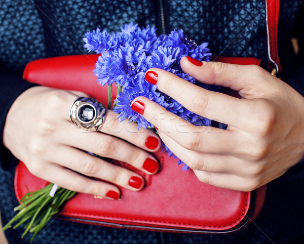 close up portrait of girls manicured hands holding small cute red handbag and cornflower bouquet, li Stock photo © iordani