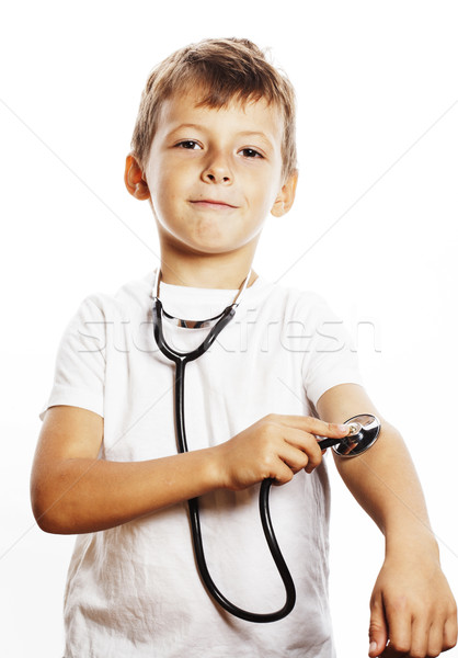 little cute boy with stethoscope playing like adult profession d Stock photo © iordani